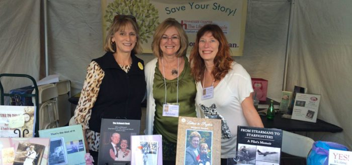 Trade show group photos with books